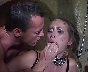 Mandy Bright chained and double penetrated in her cunt.